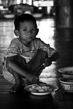 A boy so hungry. With b&w Stock Photos