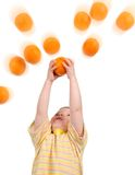 Boy hunts for orange Stock Image
