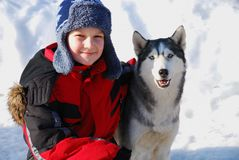 Boy with husky dog Stock Photo