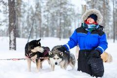 Boy with husky dog Stock Photo