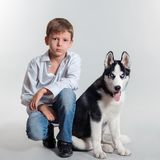 Boy and husky dog Royalty Free Stock Photo