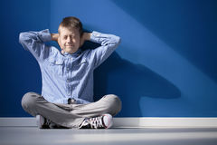 Boy with hypersensitive auditory Stock Images