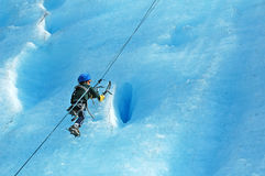 Boy ice climbing Royalty Free Stock Photos