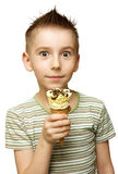 Boy with ice cream. Surprised boy with ice cream in his hand isolated on white Royalty Free Stock Photo