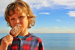 A boy with an ice-cream Stock Photos