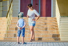 Boy with Ice Cream Being Scolded by Angry Mother Stock Photo