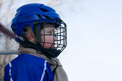 Boy ice hockey player plays hockey. Child 7 years royalty free stock photos