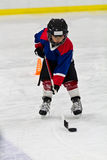 Boy at ice hockey practice Stock Image