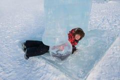 Boy in ice sculpture, urban esplanad Royalty Free Stock Photography