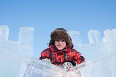 Boy with an ice sculpture Stock Image