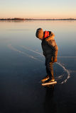 Boy ice skating Stock Photo