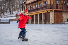 Free Boy Ice Skating For The First Time Royalty Free Stock Images - 168426769