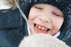 Boy with icicle Stock Images