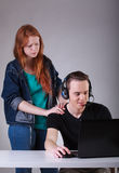 Boy ignoring girlfriend while playing computer games Royalty Free Stock Photo