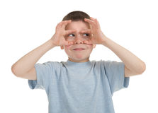 Boy imitates binoculars Royalty Free Stock Images