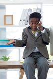 Boy imitating as businessman gesturing while talking on smartphone Royalty Free Stock Images