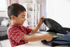 Free Boy In Bedroom Packing Bag Ready For School Stock Photography - 127005592