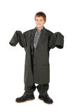 Boy In Big Man S Suit And Boots Standing Isolated Stock Photography