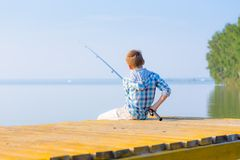 Boy In Blue Shirt Sit On A Pie Royalty Free Stock Photos