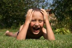 Boy In Grass Stock Photos