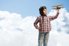 Free Boy In Helmet Pilot Playing With A Toy Airplane Stock Images - 30179994