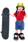 Boy In Large Shoes With Helmet And Skateboard Over White Royalty Free Stock Photos