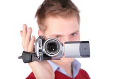 Boy In Red Jacket With HDV Camera Royalty Free Stock Photography