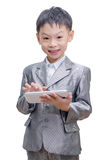 Boy In Suit Using Tablet Computer Stock Images