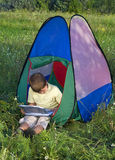 Boy In Tent Sunny Day Stock Photography