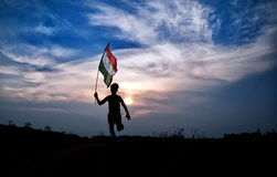 Boy with indian national flag. On green grass stock photos