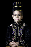 Boy in Indonesian costume. A young boy in a traditional Javanese or Indonesian costume Royalty Free Stock Images