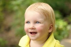 Boy infant smile with blue eyes on adorable face. And blond hair on natural environment. Child, childhood, family. Happiness, innocence, infancy, future concept stock images