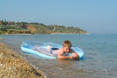 Boy in an inflatable boat Stock Images