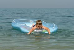 Boy in an inflatable boat Stock Photos