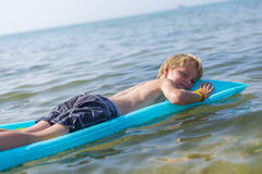 Boy  on inflatable mattrass Royalty Free Stock Image