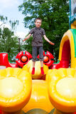 Boy in inflatable playground Stock Photography