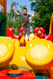 Boy in inflatable playground royalty free stock image