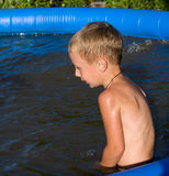 The boy in inflatable pool. Royalty Free Stock Images