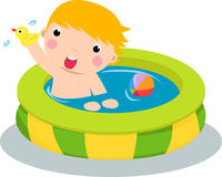 Boy in inflatable pool Stock Image