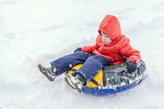 Boy with the inflatable sledge, snow tube Stock Image