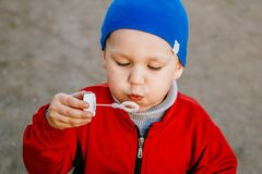 Boy inflates soap bubbles. On a walk Stock Photography