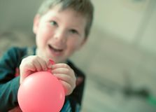 Boy playing with ballon stock photos