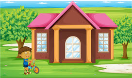 A boy infront of house Stock Photography