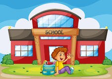 Boy infront of school Stock Image