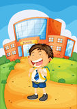 Boy infront of school Royalty Free Stock Image