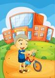 Boy infront of school Royalty Free Stock Photos