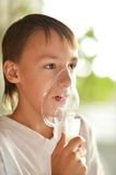 Boy with inhalator Royalty Free Stock Photos
