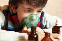 Boy with inhalator inhale seam medicine Stock Image