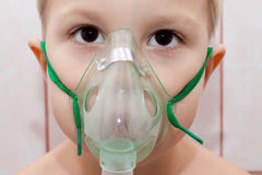 Boy in inhaler. Portrait of a boy in a mask for inhalation closeup Royalty Free Stock Image