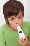 Boy with inhaler Stock Photo